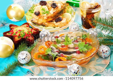 carp in jelly with carrot and cranberry and other traditional polish dishes on christmas table