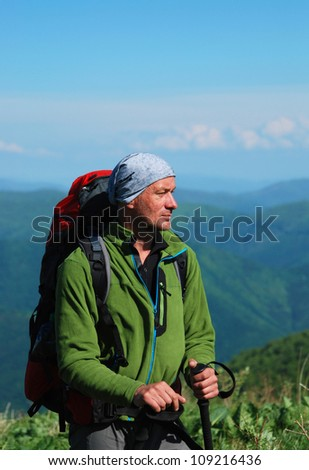 Carpathian Mountains. Hiker with backpack viewing trip