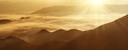 Carpathian mountains summer golden sunrise landscape with  foggy river - panoramic view