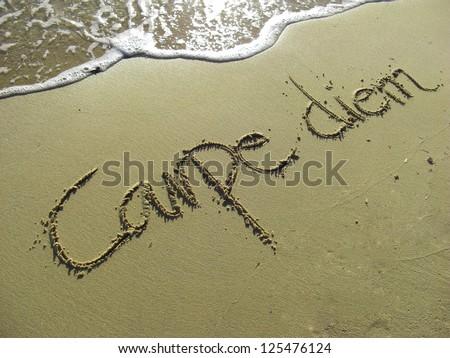 Carpe Diem Phrase in Sand on the Beach