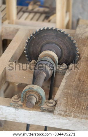 Carpenter cutting flaxboard using sliding compound mitre saw #304495271