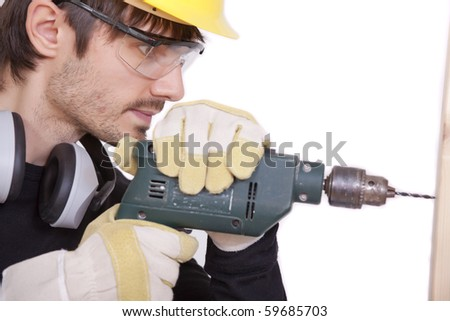 carpenter drilling in woods - isolated on white background