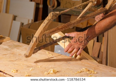 Carpenter hands using  traditional tools