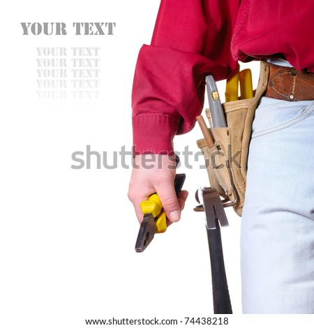 Carpenter in tool belt closeup holds pliers over white background