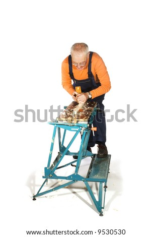 carpenter is making wood sliced - stock photo