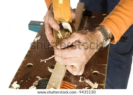carpenter is slicing the wood