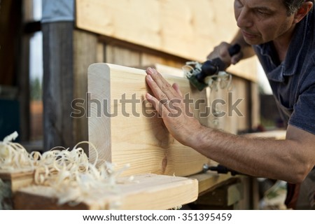 Carpenter manufactures stair treads/Steps to a Wooden Ladder