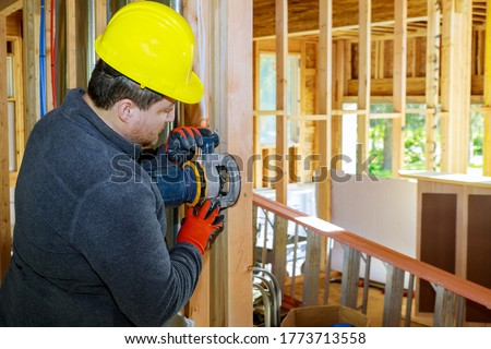 Carpenter milled with woodworking router in a wood furniture manufacturing