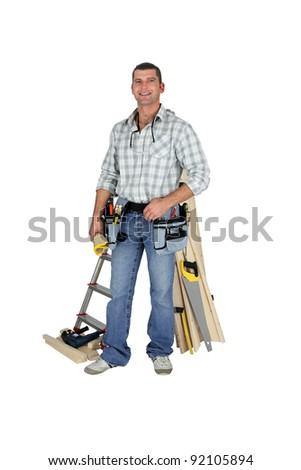 Carpenter posing by his equipment - stock photo