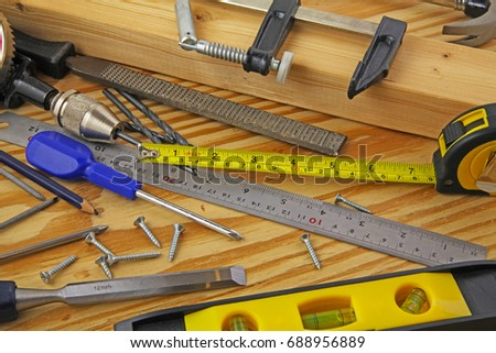 Carpenter tools – A carpenters bench with various tools #688956889