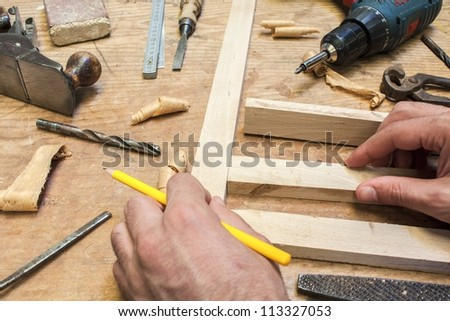 carpenter tools,hammer,meter and screw-driver on construction background