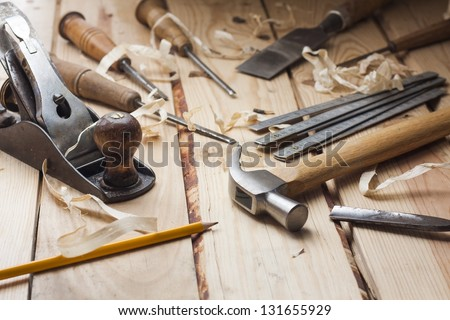 carpenter tools,hammer,meter,nails,shavings, and chisel over wood table