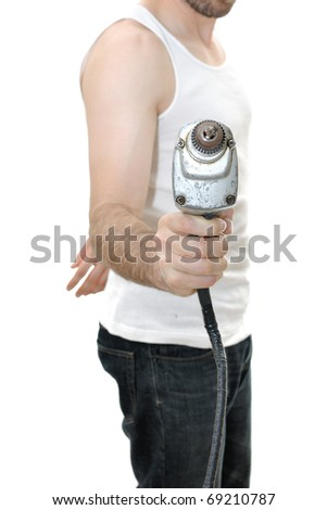 Carpenter with an electric vintage drill