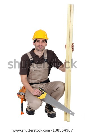 Carpenter with hand saw - stock photo