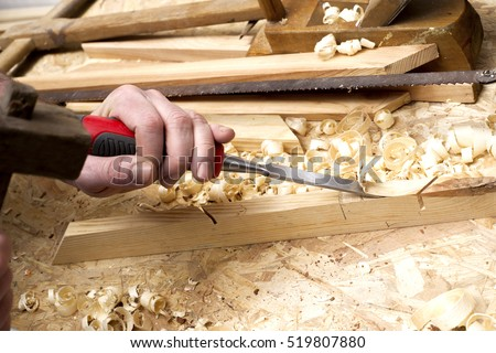 carpenter working,hammer,meter and screw-driver on construction background. Copy space for text.