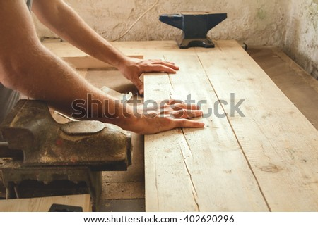 Carpenter working hard in his small \