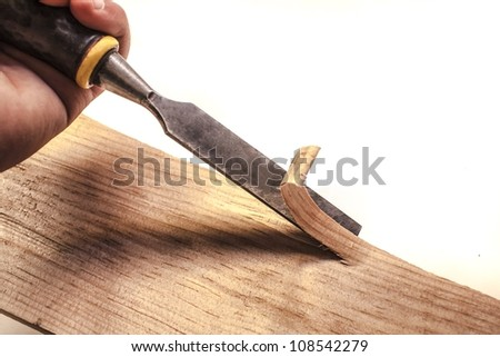 Carpenter working with chisel,isolated - stock photo