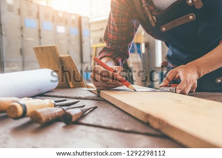 Carpenter working with equipment on wooden table in carpentry shop. woman works in a carpentry shop. Photo stock ©