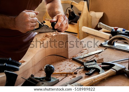 carpenter works with a planer...