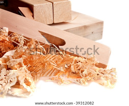 carpenters plane , wooden chips and wood isolated - stock photo