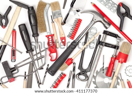 carpentry and woodwork tools on white background. carpenter working table. creative mess composition top view #411177370