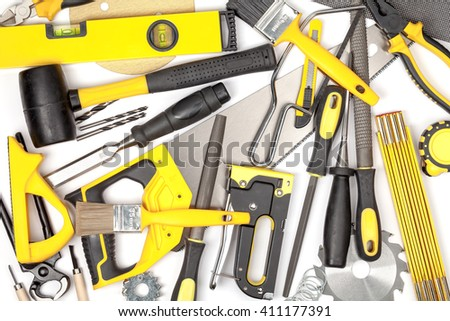 carpentry and woodwork tools on white background. carpenter working table. creative mess composition in yellow colors top view #411177391