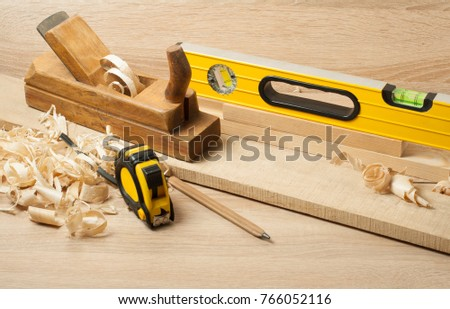 Carpentry concept.Joiner carpenter workplace. Construction tools on wooden table with sawdust. #766052116