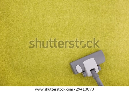 carpet cleaning with a vacuum cleaner - stock photo