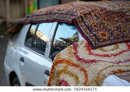 carpet standing on the car  Stok fotoğraf ©