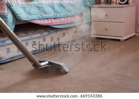 vacuuming the carpet room