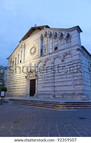 Carrara (Tuscany, Italy), the ancient cathedral, the facade at evening - stock photo