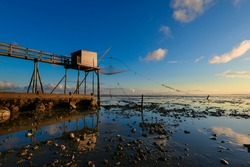 Carrelets are traditional net fishing installations in the west of France as well as in Bourgneuf-en-Retz seen at sunset where they are a major tourist attraction in the Brittany Pays de Loire region.