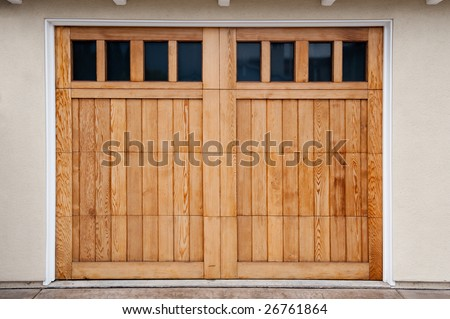 Carriage style garage doors of a contemporary home.