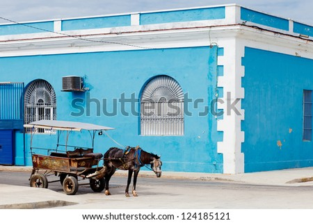 carriage with horse over blue...