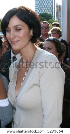 Carrie-Anne Moss walks at the Toronto Film Festival