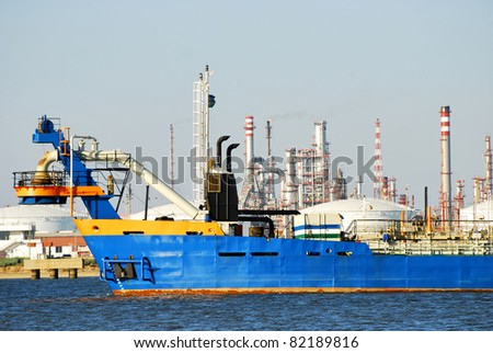 Carrier ship and oil i gas factory in port Huelva, Spain