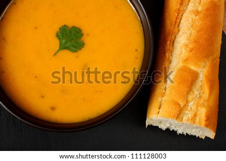 Carrot and coriander soup with bread stick