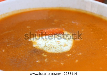 Carrot  and orange soup with a dollop of creamy yogurt and sprinkle of thyme