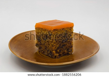 Carrot cake on a brown plate. Isolated with white background Zdjęcia stock ©