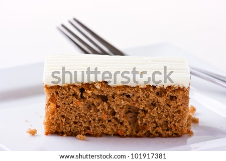 Carrot Cake on white plate with fork. Isolated on white. Sallow depth of field