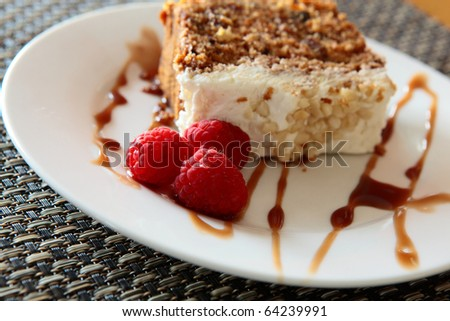 Carrot Cake With Raspberries and Chocolate on a Plate