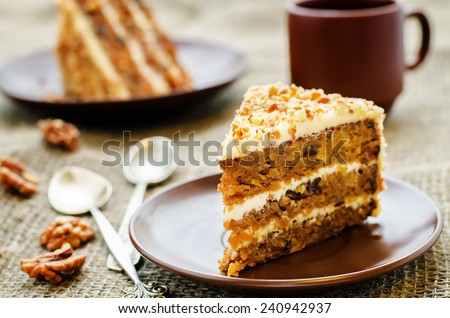 carrot cake with walnuts, prunes and dried apricots on a dark background. tinting. selective focus