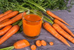 Carrot Juice a lot of vitamin A. Protects Eye. High Source of Antioxidants Especially Beta Carotene. Decreases Risk for Heart Disease. Helps Protect Against Cancer. Raw carrots and juice in a glass