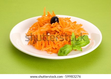 carrot salad with pine nuts and olives