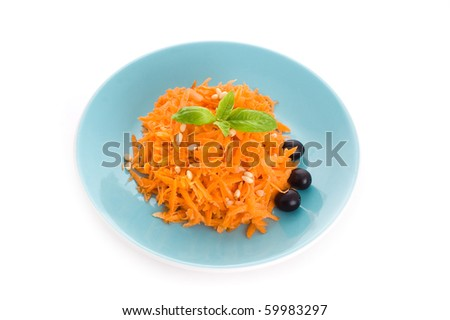 carrot salad with pine nuts and olives isolated on white background