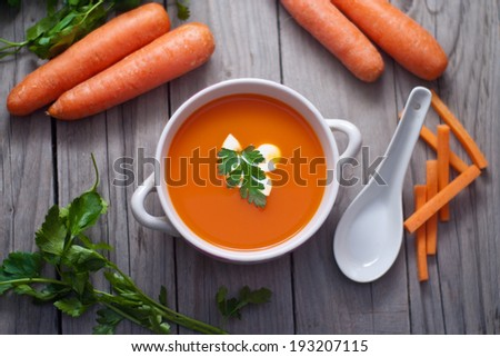 Carrot soup in a porcelain bowl