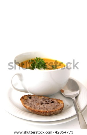 Carrot soup with bread on white