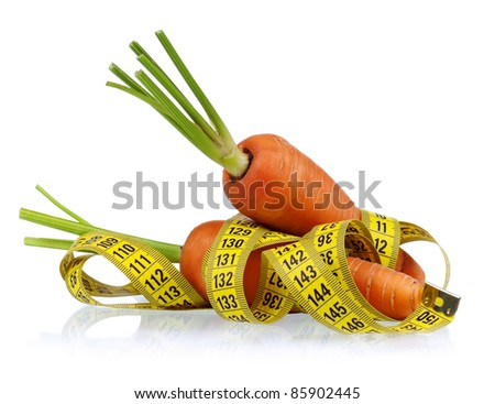 Carrot with a measure tape wrapped around over a white background