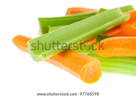 Carrots and celery isolated on white