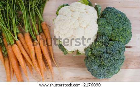 carrots,broccoli, and cauliflower on a board #2176090